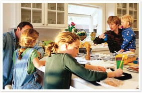 Family in Kitchen of new home
